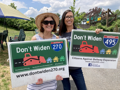 Kristin and rally organizer hold signs stating Don't Widen 270 and Don't Widen 495