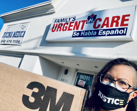 Kristin delivers free 3M masks to a local bilingual urgent care center on behalf of the nonprofit she cofounded, Masks For America.