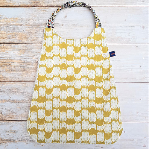 Serviette élastiquée personnalisable coton oeko tex motif cacahuètes moutarde