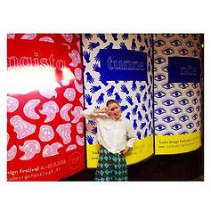 Graphic designer Johanna Bruun infront of huge marketing posters for Turku Design festival 2016 in shoppingcenter Forum.