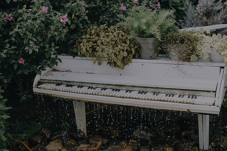 White%20piano%20waterfall%20with%20flowe