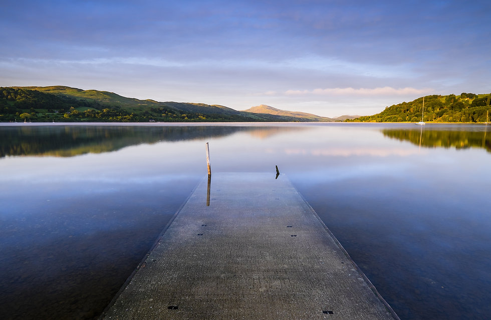 Bala Lake jetty at sunrise with the moun