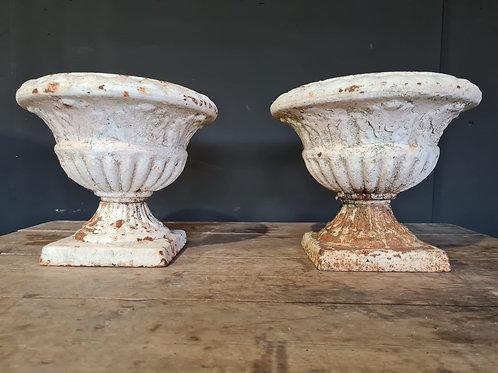 Pair of cast iron white urns