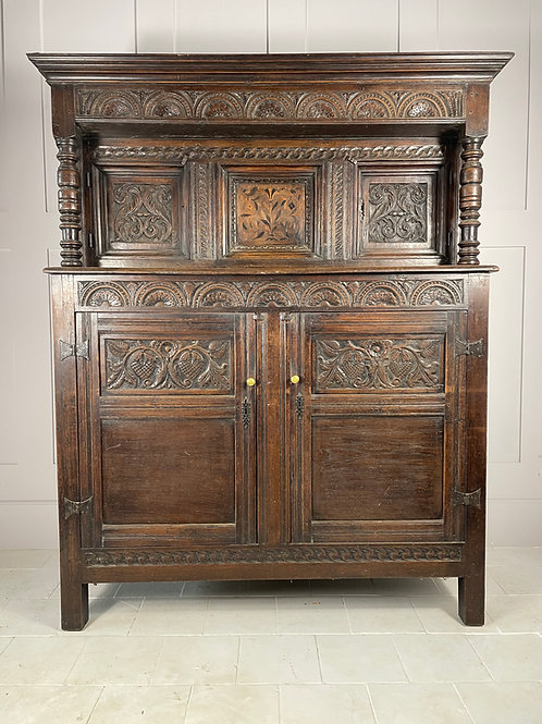 Welsh oak craved court cupboard