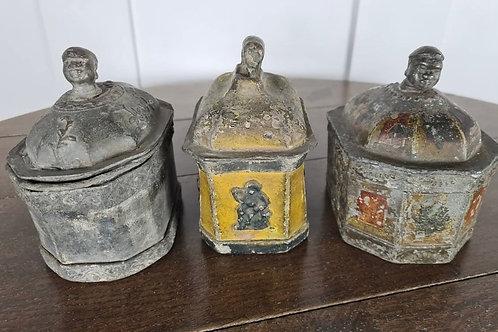 Trio of lead tobacco boxes