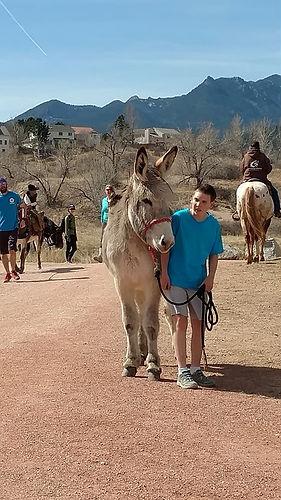 FOTESC poker ride mule with boy.jpg