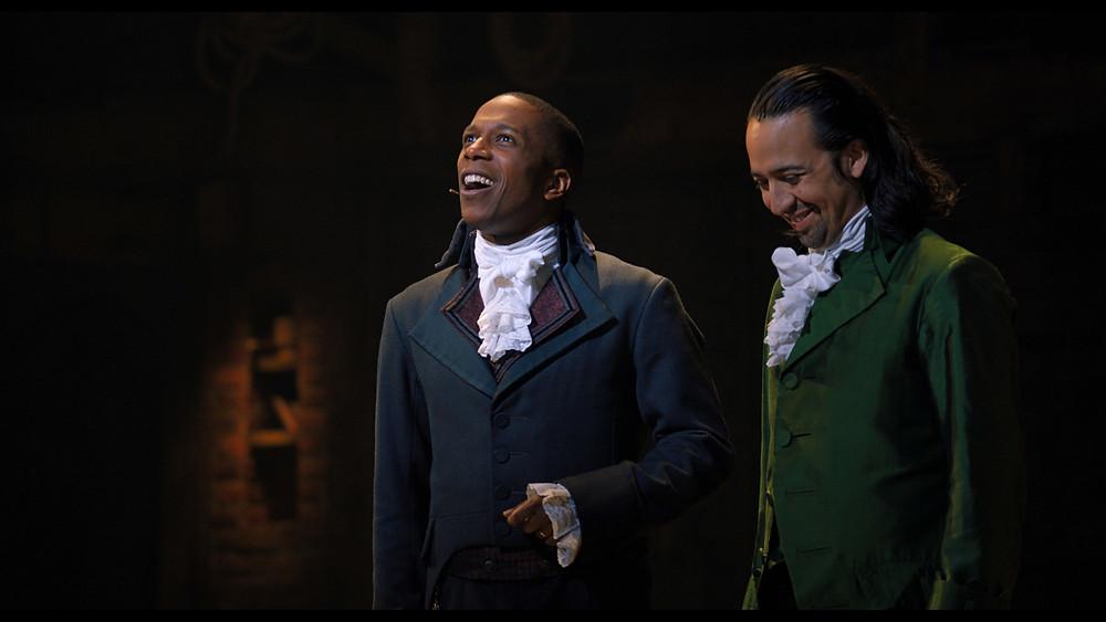 Leslie Odon Jr. as Aaron Burr in Hamilton on Broadway on left, Lin Manuel-Miranda on right