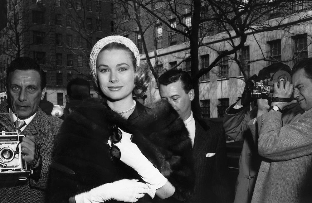 glamorous shot of grace kelly smirking for the camera in her fur outside in new york city
