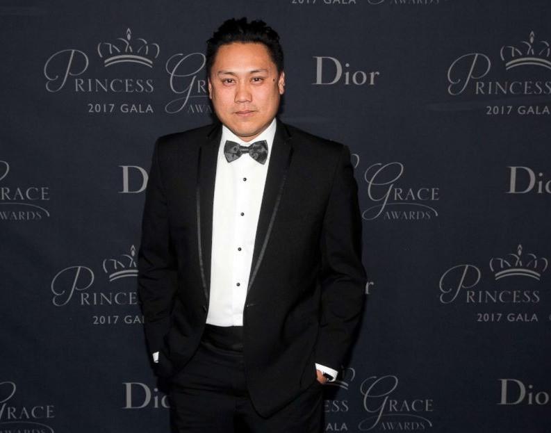 Jon M Chu at the Princess Grace Foundation-USA Gala, posing on the red carpet