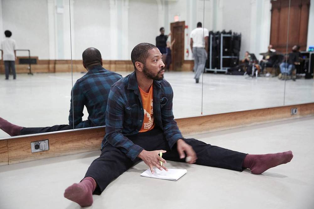 Celebrated choreographer Kyle Abraham observes dancers as they rehearse at New York City Center.
