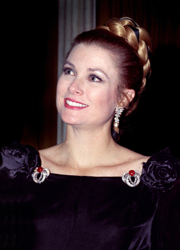 Princess Grace dressed up for her Zodiac Scorpio Birthday Party Extravaganza wearing her brooches