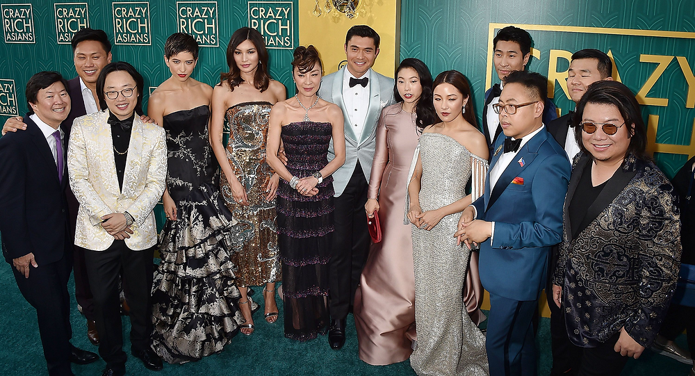 """The """"Crazy Rich Asians"""" cast with director Jon M. Chu (second from left) and executive producer Kevin Kwan (far right)"""