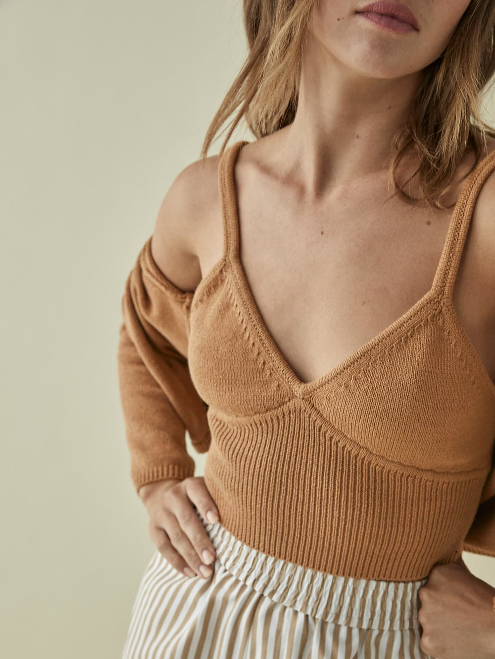 toffee colored sweater set from Reformation worn by model