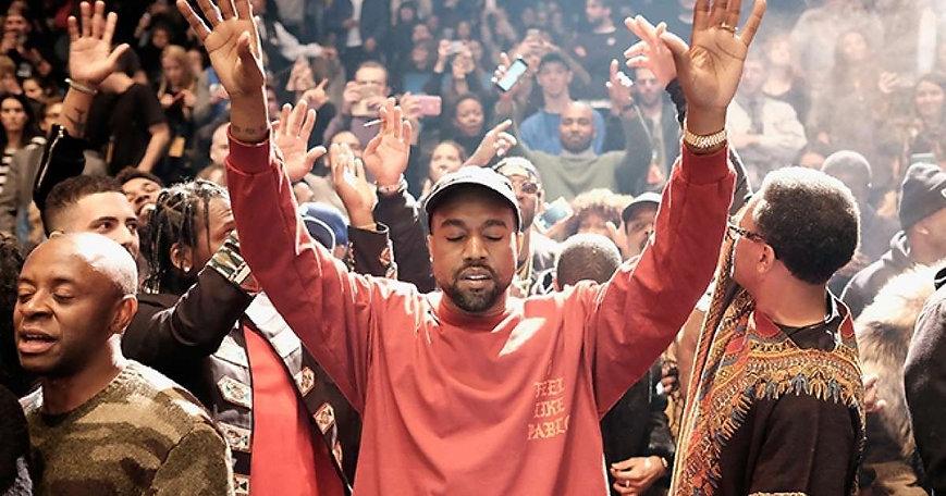 Kanye-West-hands-up-in-prayer.jpg