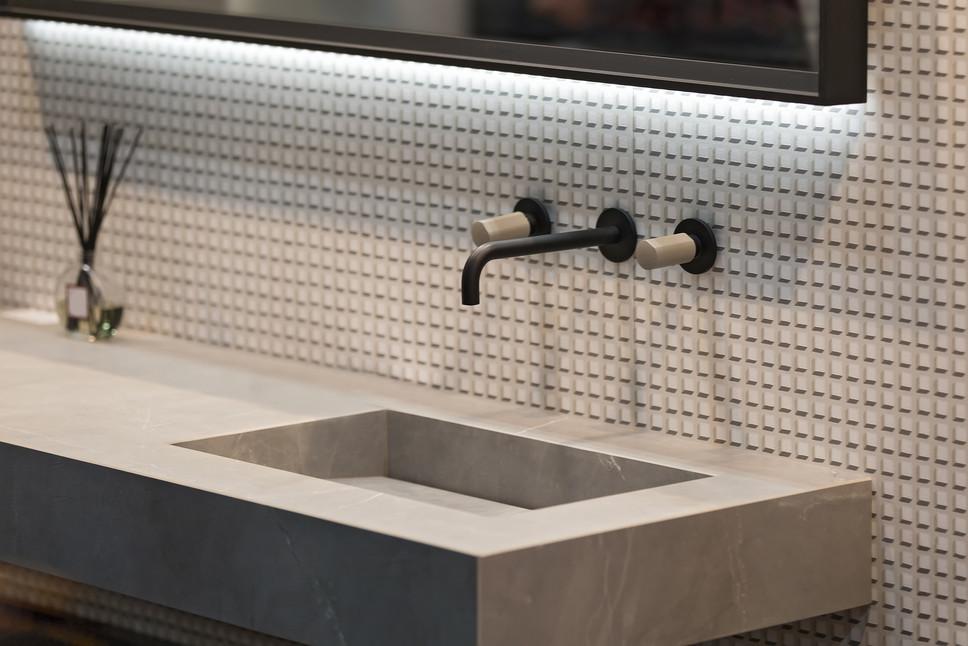 Bathroom interior grey marble sink and b