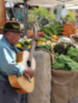 Man playing guitar at Farmers Market