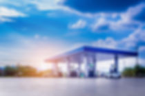 Gas fuel station with clouds and blue sk