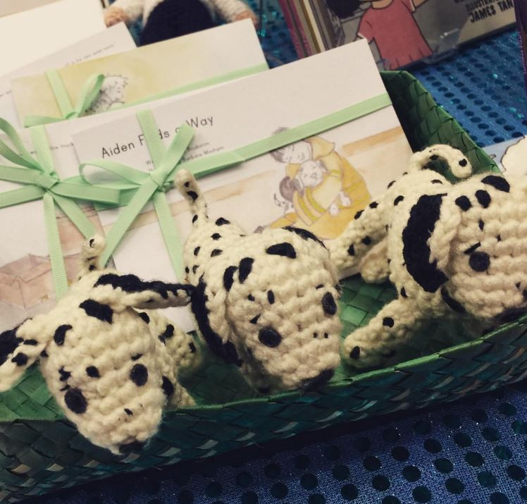 Handmade crochet puppies and postcards from Aiden Finds a Way