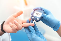 Doctor checking blood sugar level with g
