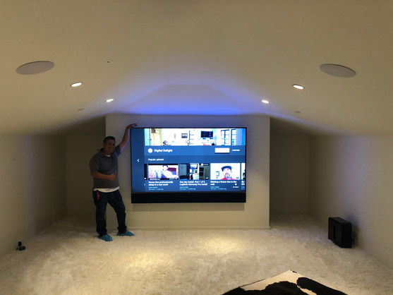 "77"" Sony OLED TV Mounted in Theater Room"