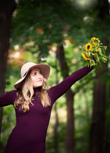 JBella Photography Kim Messina Senior Portraits Ny Suffolk county Nassua County Senior portrait photographer   smiling holding flowers