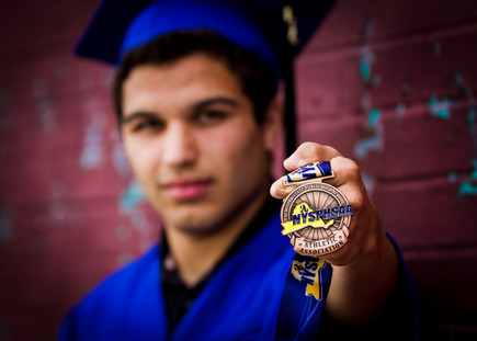 high school senior portrait holding metal male boy