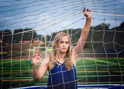 JBella Photography Kim Messina Senior Portraits Ny Suffolk county Nassua County Senior portrait photographer girl on field LAX goal