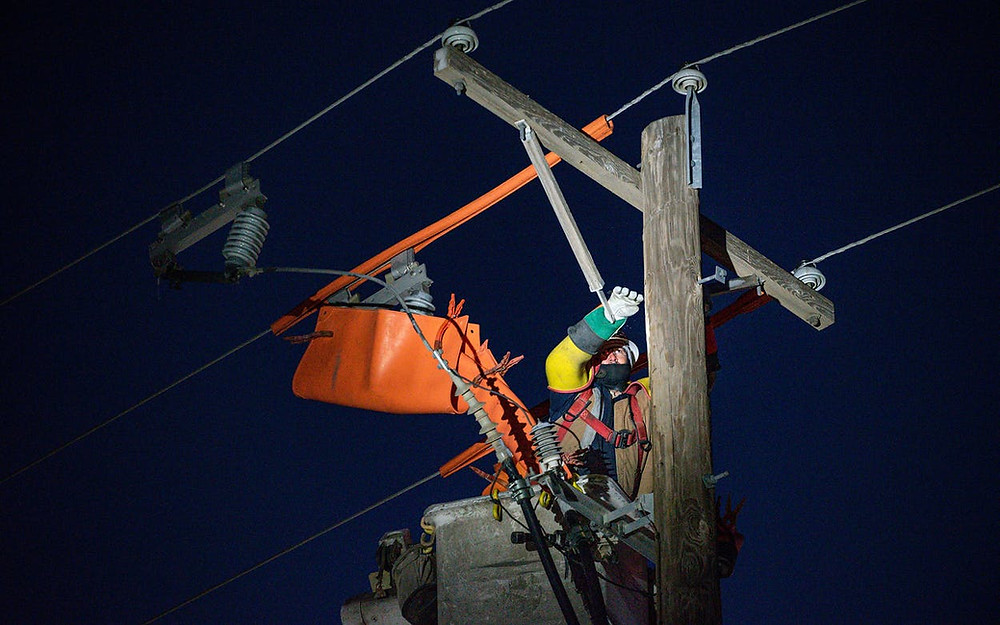 Lineman working a night job