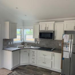 Classy stainless steel kitchen, corner sink,