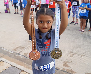 medals and little girl.jpg