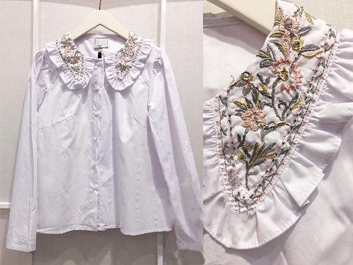 Camisa flores bordadas