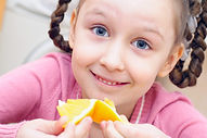 girl eating an orange.jpg