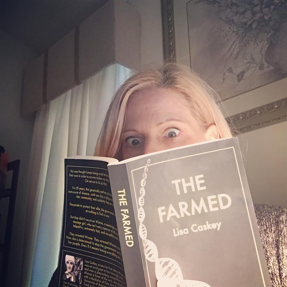 Melissa reading The Farmed
