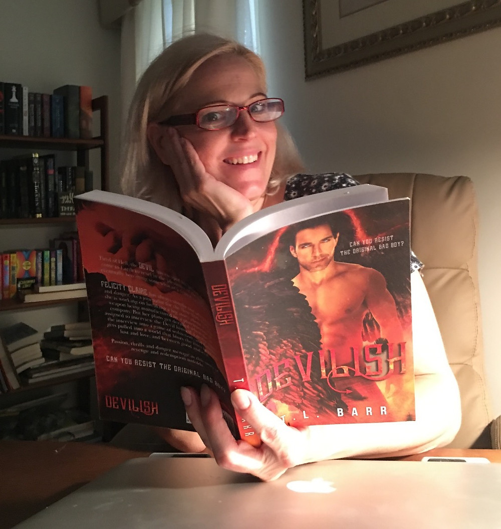 Melissa reading Devilish by Tricia Barr
