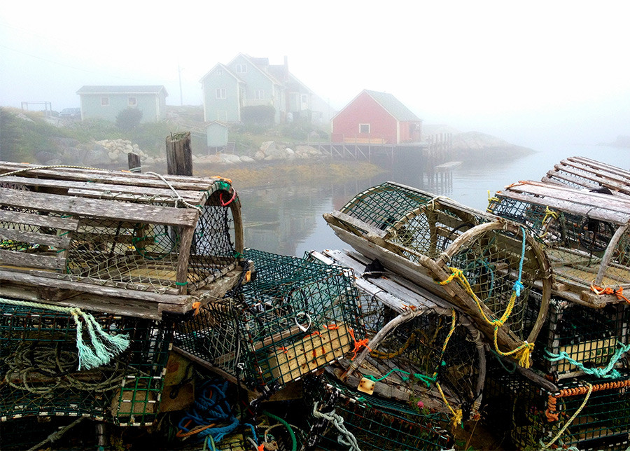 5 Tips For Photographing Fog: Use layers to create depth, as in this photo of Lobster Traps and Fog in Peggy's Cove, NS, by Tracy Munson.