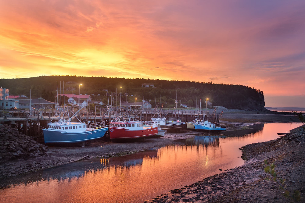 Fishing boats, beached at low tide in Alma, on the Bay of Fundy in New Brunswick.