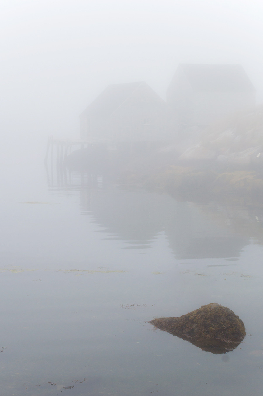 5 Tips For Photographing Fog. A very foggy morning in Peggy's Cove.