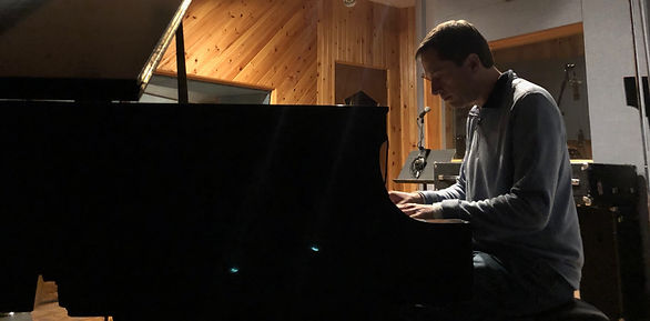 "Kurt Reiman playing a 1929 Steinway grand piano during the recording of his debut album, ""North Maple Road,"" at Inception Sound Studios in Toronto"