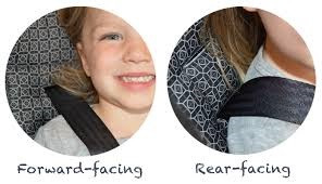 Straps should be at or above the shoulders for forward facing, and at or below the shoulders for rear facing.
