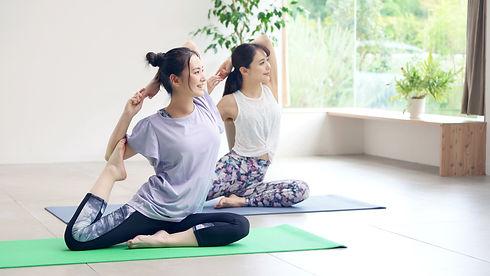Young asian women doing yoga. Yoga instr