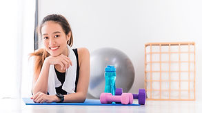 Asian woman smiling and resting after pl