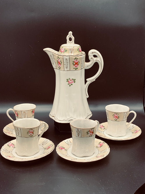 Antique chocolate pot with 4 cups and saucers