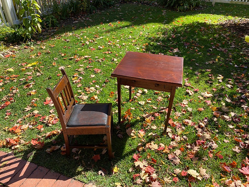 Primitive table and child's chair.