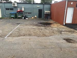 BEFORE - Puddle in rear asphalt carpark - Scarborough Perth