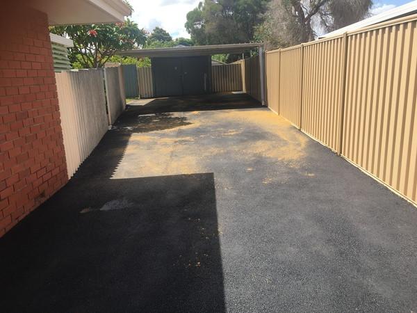 Black asphalt/hotmix resurfaced driveway