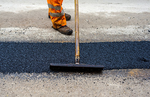 Construction Worker during Asphalting Ro