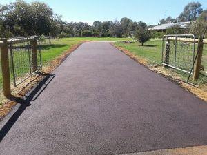 Red asphalt rural driveway