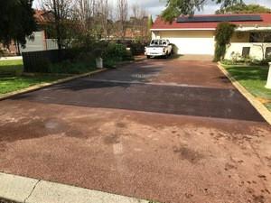 Red bitumen driveway repairs