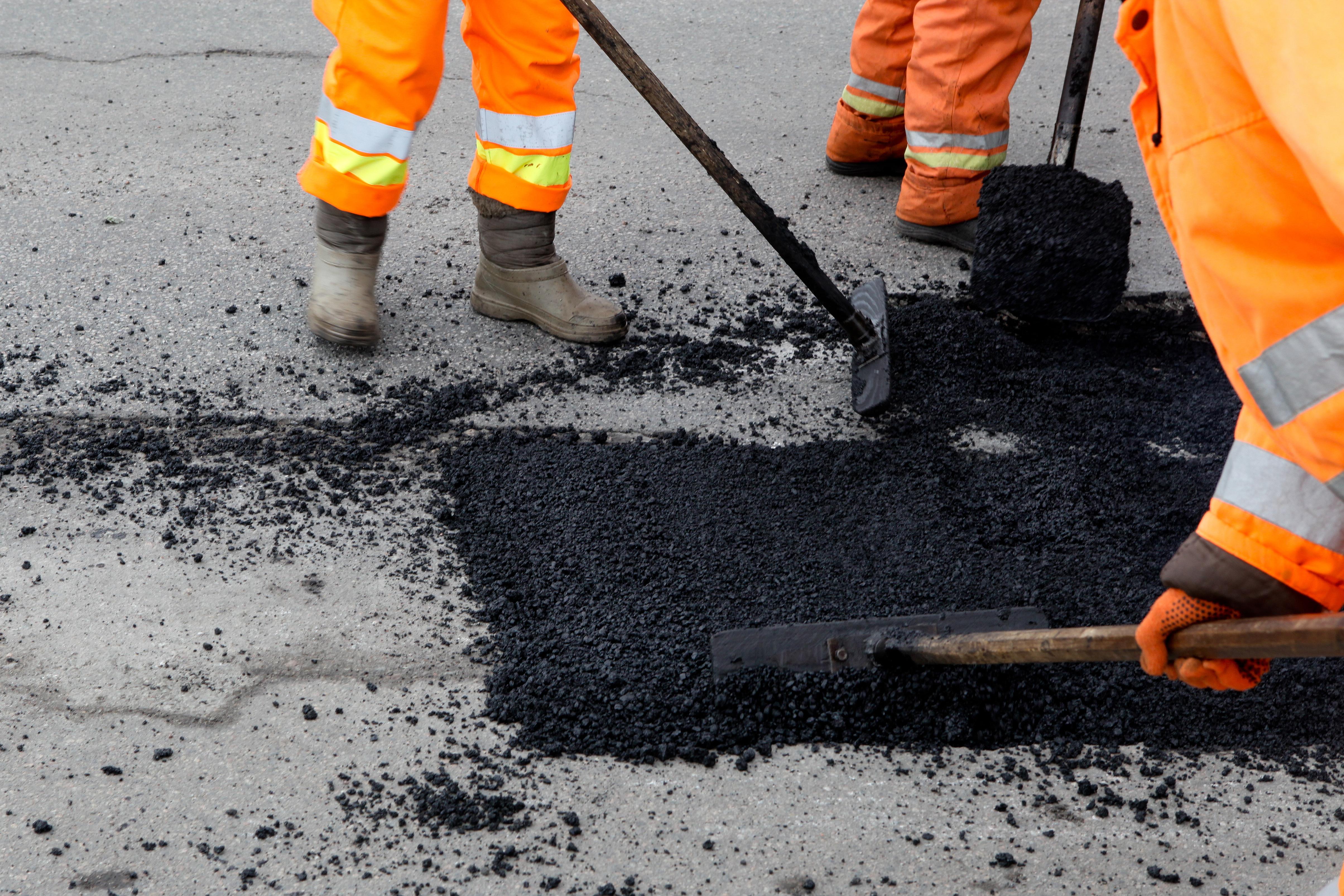 Street resurfacing. Fresh asphalt constr