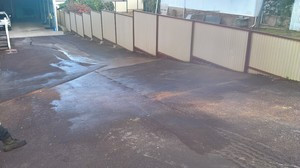 Red bitumen driveway - repair patch
